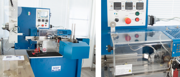 Machine for cutting and folding fabric labels